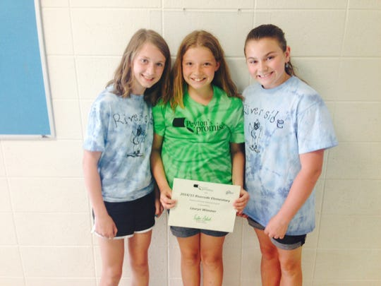 Riverside Elementary Lauryn Wimmer has been selected to lead Mountain Bay Elementary in the fight against hunger for the 2014-2015 school year. Pictured are Emma Footit, from left, Lauryn Wimmer and Dani Langseth.