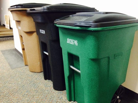 Different sizes of trash and recycling bins used in an automated collection system for consideration by City Council members on Jan. 19, 2015 in Wausau City Hall. The Public Health and Safety Committee approved a request for proposals for a refuse and recycling contract to begin in 2016.