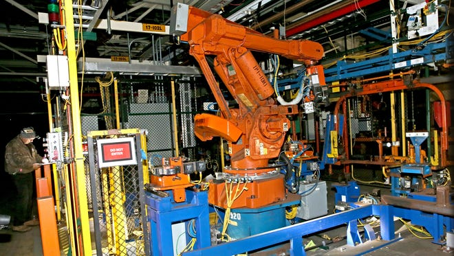A robotic cell sits inside the GM Janesville assembly plant. Equipment and machinery are being auctioned off by the factory's new owner as it prepares the site for redevelopment.