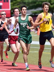 Novi's Scott MacPherson (second from right) keeps pace