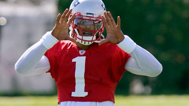New England Patriots quarterback Cam Newton waits for the ball during training camp practice in Foxborough, Mass. [Steven Senne/The Associated Press] Pool)