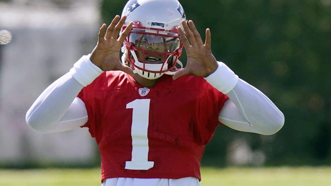 New England Patriots quarterback Cam Newton waits for the ball during an NFL football training camp practice, Tuesday, Aug. 18, 2020, in Foxborough, Mass.