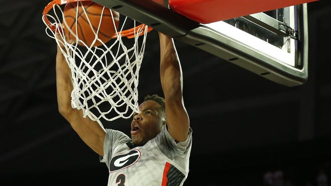 Georgia's Christian Brown (3) dunks the ball during an NCAA basketball game between Mississippi and Georgia in Athens, Ga., on Saturday, Jan. 25, 2020. Mississippi won 70-60.