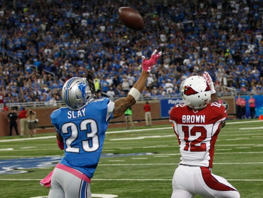 Cardinals WR John Brown catches a long pass over Lions