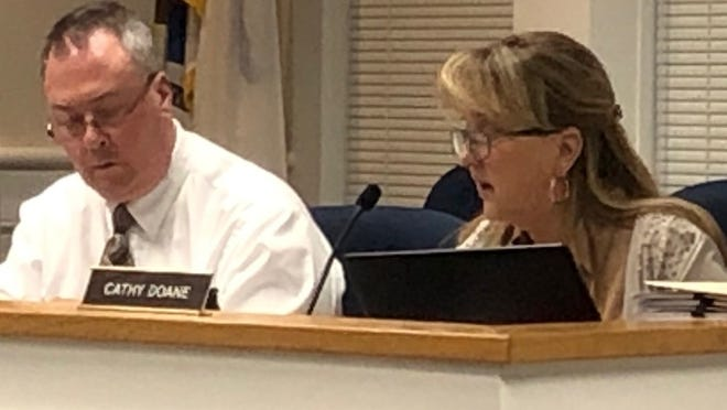 Orleans Finance Director Cathy Doane, right, shown with Town Administrator John Kelly, says the town is in a strong fiscal position, although budget cuts are still possible.