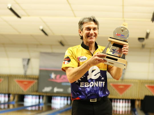 Amleto Monacelli celebrates with the 2015 Senior Masters Trophy after defeating Pete Weber in consecutive matches to claim the title.