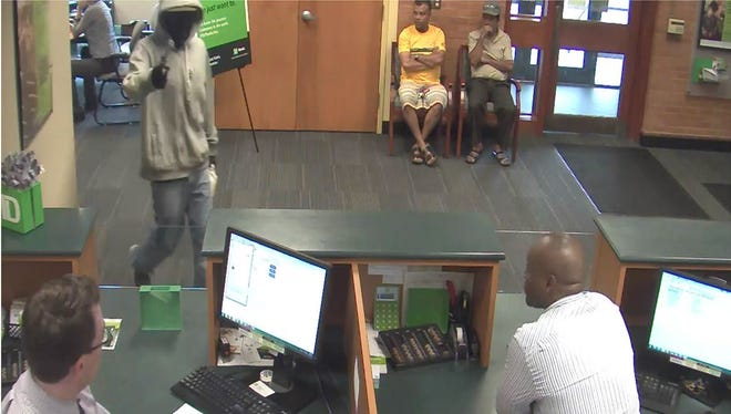 Winooski Police Department is seeking a man suspected to have robbed TD Bank on East Allen Street at gunpoint on Thursday.