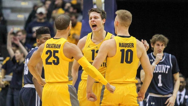 Matt Heldt (center) made all four of his shots and scored 11 points in Marquette's victory on Friday night.