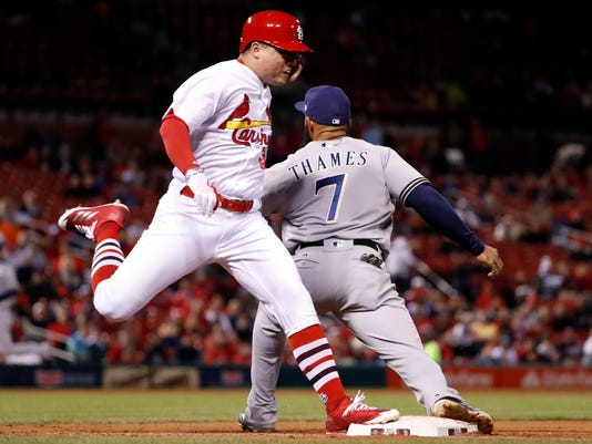 St. Louis Cardinals' Aledmys Diaz, left, is safe at first for a single as Milwaukee Brewers first baseman Eric Thames handles the throw during the fifth inning of a baseball game Thursday, May 4, 2017, in St. Louis. (AP Photo/Jeff Roberson)