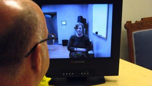 Former Planned Parenthood physician Tom Ross demonstrates a telemedicine system that lets physicians in Des Moines visit with patients in satellite clinics and dispense abortion pills to them.