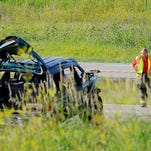 Firefighters and rescue workers on the scene of a mulitple-car accident on I-96 near Grand Ledge Thursday.