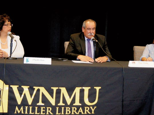 Priscilla Lucero, executive director of the Southwest New Mexico Council of Governments, from left, Rudy Martinez, former state representative, and Arlean Murillo, vice president of the Associated Students of WNMU, take part in a forum on capital outlay on Thursday at the Miller Library on campus.