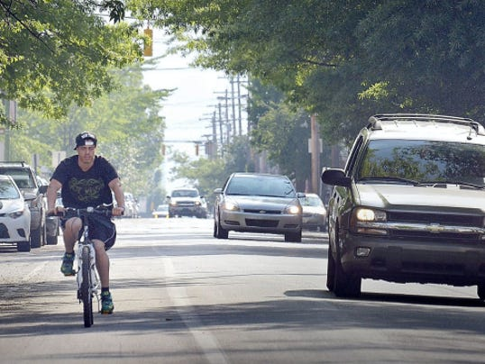Nelson Valentin takes advantage of the bike lane on West King Street on Sunday. York City was slated to start a project Monday that will extend the bike lanes farther east.