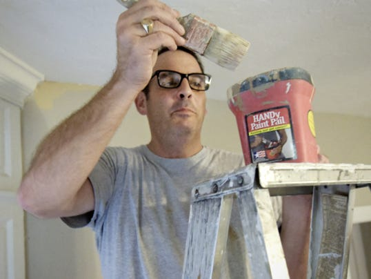 Tom Kelley paints a wall Monday in his new law office at 103 E. Philadelphia St. Kelley stepped down as a York County Court of Common Pleas judge to pursue a private practice.