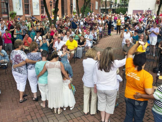 Married couples are applauded by the crowd during last year's Equality Fest on Cherry Lane in York.