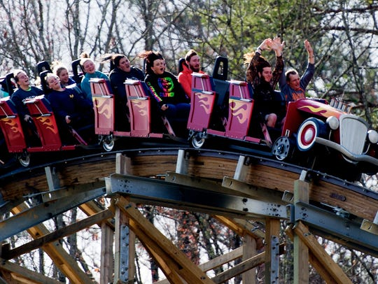 Visitors ride Lightning Rod during opening day at Dollywood