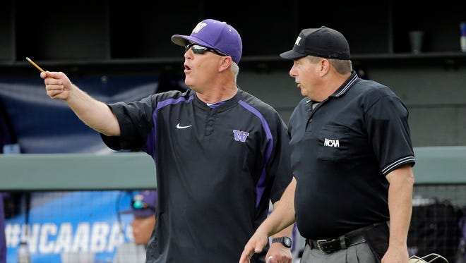 FILE - In this June 3, 2016, file photo, Washington head coach Lindsay Meggs, left, argues a call with home plate umpire David Savage during an NCAA college baseball regional tournament game in 2016. On Saturday, the Huskies face Mississippi State in the first-round of the College World Series. It's the first trip to Omaha in Washington's history, finally fulfilling the promise of a program that at times has featured great players and great teams, but has never put together a postseason run good enough to find its way to the CWS.