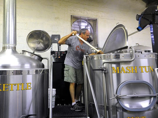 Czann's Brewing Co. owner Ken Rebman prepares a Dunkelweizen beer in his small facility in SoBro. His business eventually plans to move from 505 Lea Ave.
