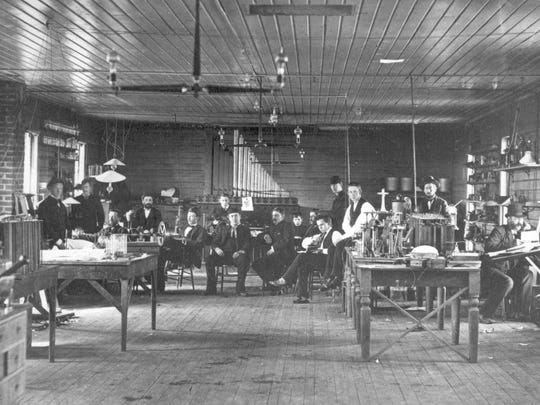 An 1880 photo shows employees of Thomas Edison's Menlo Park, New Jersey laboratory. In the background, you can see the original 1878 that had been given to Edison by the Roosevelt Organ Works. Photo: provided/The Henry Ford.