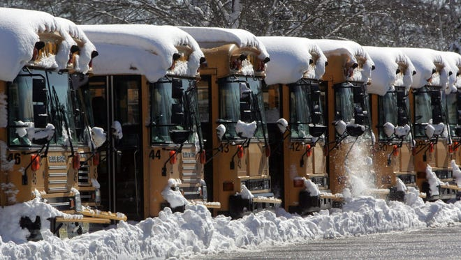 Buses of the Toms River School district covered with snow