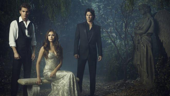 "From left, Paul Wesley as Stefan, Nina Dobrev as Elena, and Ian Somerhalder as Damon in ""The Vampire Diaries."""