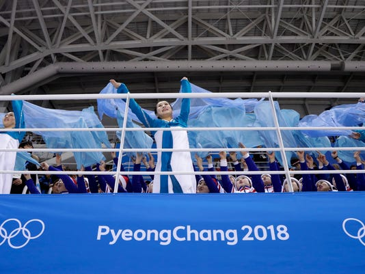 Korean supporters cheer during the second period of the preliminary round of the women's hockey game between Sweden and the combined Koreas at the 2018 Winter Olympics in Gangneung, South Korea, Monday, Feb. 12, 2018. (AP Photo/Julio Cortez)