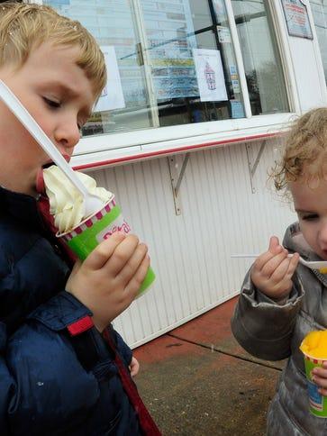 Robbie Heinl, 4, and his sister, Sarah, 2, enjoy their
