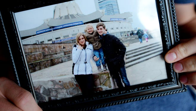 Foreign exchange student Yehor Holkov, who is from Ukraine, shows a picture of his mother and sister.