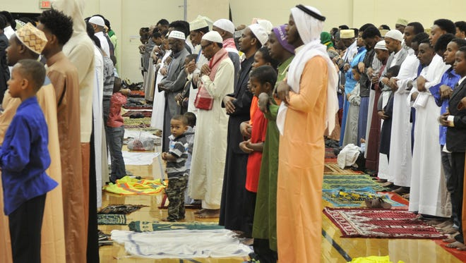 Worshipers pray Sunday at Tech High School during a ceremony marking the end of Ramadan.