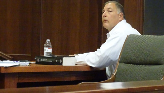 Martin Tremmel listens to testimony at his trial Monday. Tremmel was charged with domestic violence against his wife, Joyce.
