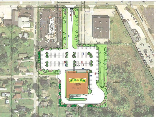 Fresh Thyme Farmers Market has won zoning approval for a natural/organic grocery on McGalliard Road near Cardinal Greenway, top right, and a Muncie Liquors store, top left, to be demolished for a Crew Carwash.