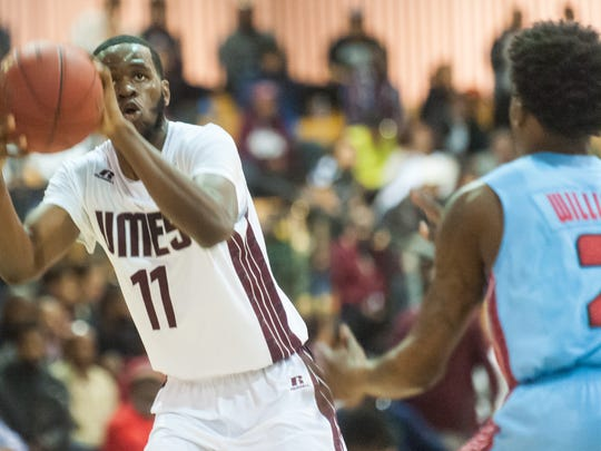 UMES guard Devon Walker (11) takes a shot against Del State at the W.P. Hytche Athletic Center on Saturday afternoon.