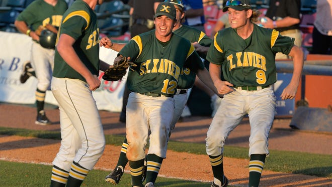 St. Xavier's Tanner Brown, right, and Sam Hedges, center, rush out to celebrate with pitcher Connor Holden following their 1-0 victory in their Kentucky State baseball championship game against Campbell County, Saturday, June 18, 2016 in Lexington Ky. Holden pitched a three hit shutout in the championship game. (Timothy D. Easley/Special to the C-J)