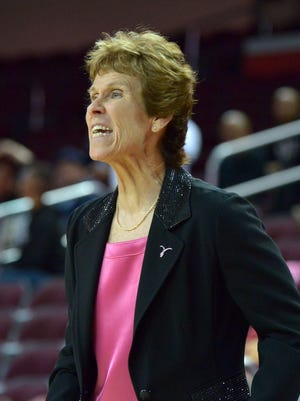 Southern California Trojans assistant coach Beth Burns reacts against the Arizona Wildcats at the Galen Center. USC defeated Arizona 77-51.