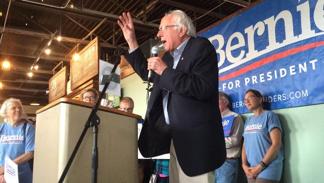 Democratic presidential candidate Bernie Sanders speaks in Ames at the Torrent Brewing Co.
