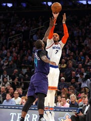 New York Knicks small forward Carmelo Anthony (7) shoots over Charlotte Hornets small forward Michael Kidd-Gilchrist (14) during the third quarter at Madison Square Garden on Jan. 27, 2017.