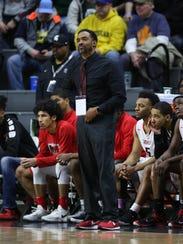 Detroit Edison PSA coach Brandon Boe Neely on the bench