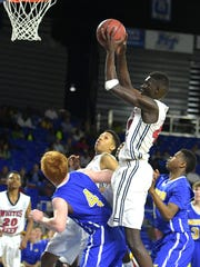 Whites Creek's Ruot Monyyong (40) shoots a jumper and scores against Westview  during a Class AA state quarterfinals game at MTSU's Murphy Center on Thursday March 17, 2016.