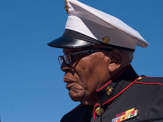 Pearl Harbor survivor Tommy Davis is honored as the