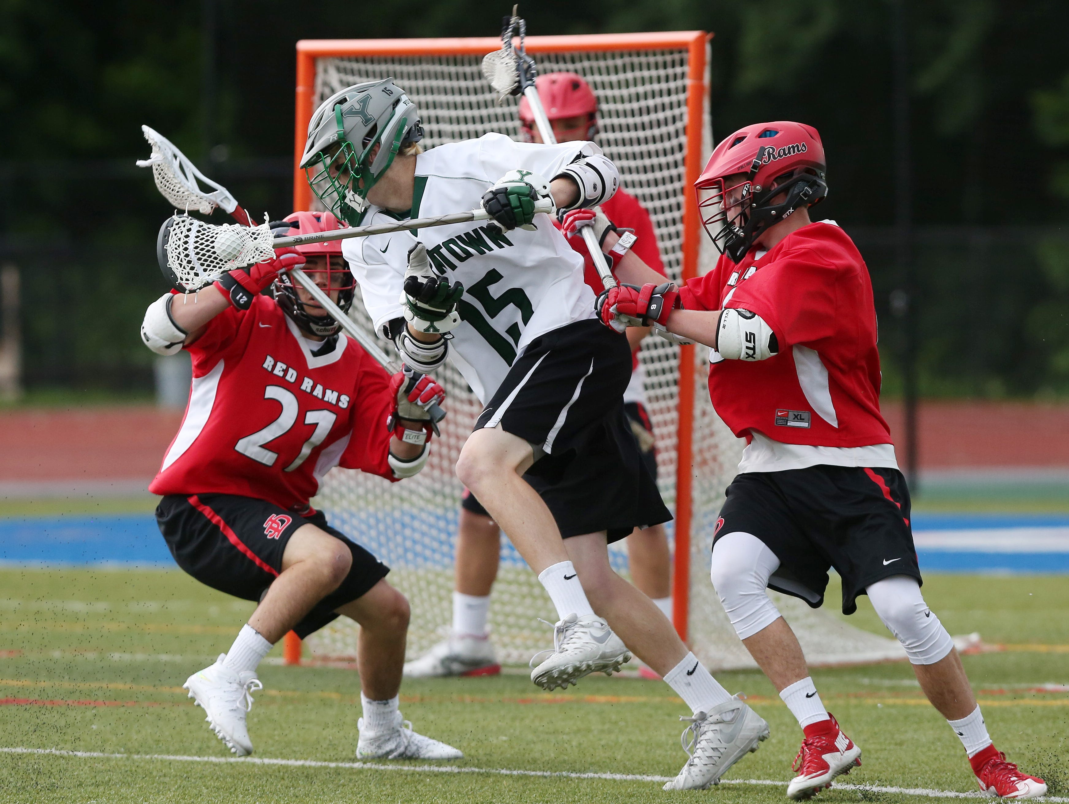 Yorktown's Kyle Casey (15) tries to drive to the goal in front of Jamesville-Dewitt's Casey Platonic (21) during the NYSPHSAA Class B championship lacrosse game at Middletown High School June 11, 2016. Jamesville-Dewitt won the game 9-6.