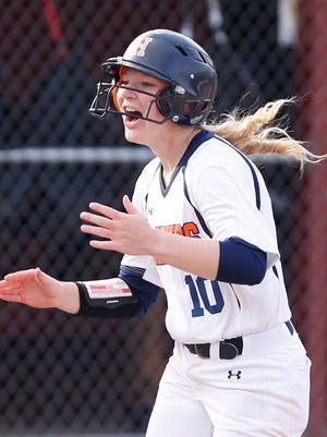 Olivia Stansbury of Harrison claps her hands as she trots to home plate after hitting a two run home run with two out in the top of the fifth inning to put the Raiders up 6-1 over McCutcheon Tuesday, April 10, 2018, at McCutcheon High School. Harrison defeated county rival McCutcheon 7-5.