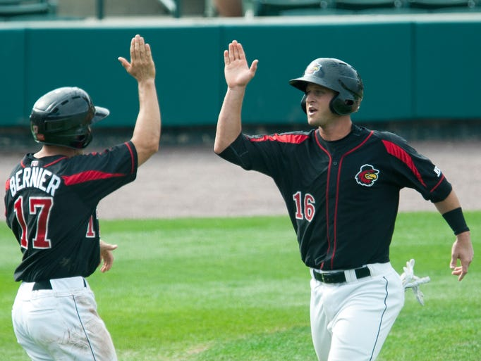 Left, Red Wing's Doug Bernier and Dan Rohlfing high five after they each got a run for a 3-2 lead in the fourth inning at Frontier Field in Rochester.