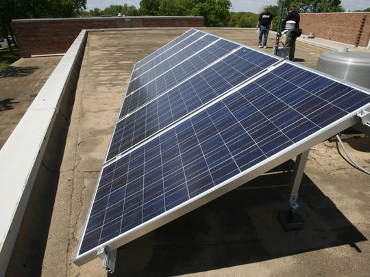 Solar panels are installed on the roof of a Des Moines School District building.