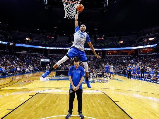 Memphis' Jimario Rivers (top) competes in the dunk competition during Memphis Madness on Oct. 12.
