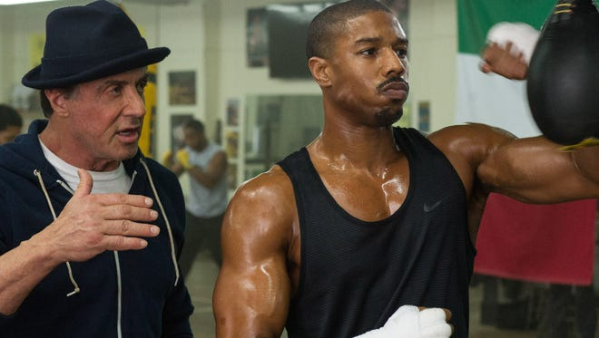 "Rocky Balboa (Sylvester Stallone, left) schools Adonis Johnson (Michael B. Jordan), a.k.a. the son of Apollo Creed, in ""Creed."""