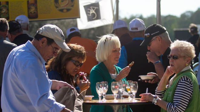 Visitors to the Friday FanFest sample beer and food at the ACE Group Classic on Friday at Twin Eagles in Naples.