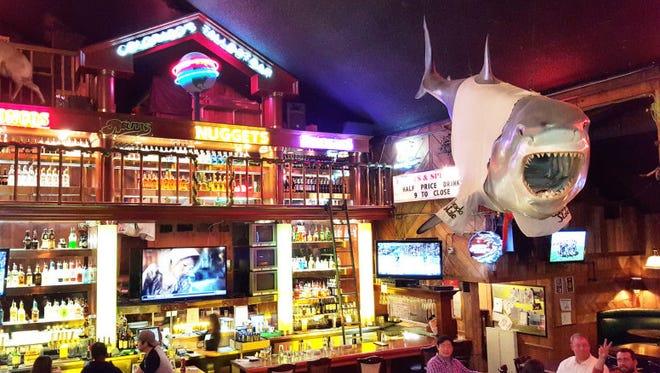 A 16-foot shark hangs above diners in the West Elizabeth Street C.B. & Potts.