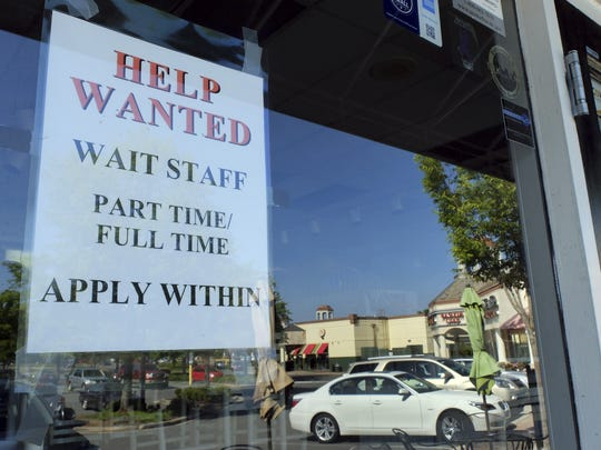 Businesses in some parts of the country are hiring again while some in regions with coronavirus spikes are cutting jobs.