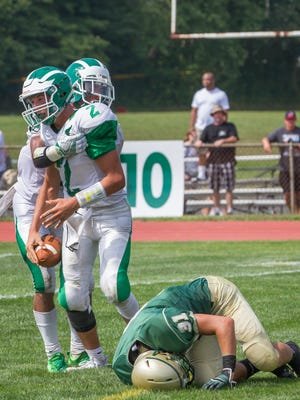Brick's Anthony Costanza celebrates with team mate after scoring his team's second touchdown. Brick vs Brick Memorial football at Brick Memorial High School on September 10,2016