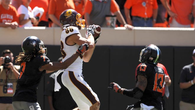 Central Michigan wide receiver Jesse Kroll catches the ball before pitching it to Corey Willis for the winning score.